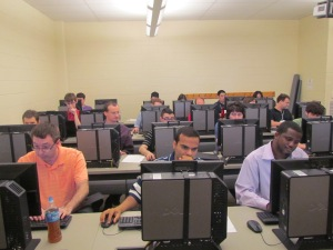 Trainees working on personal plans in computer lab.